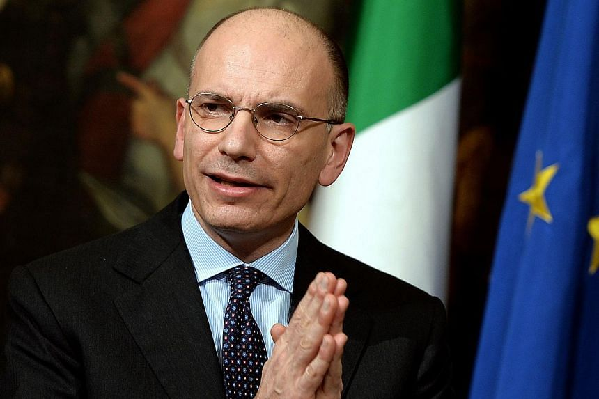 """Italian Prime Minister Enrico Letta gives press conference to present a document called """" Italy commitment"""" with his proposals in Rome's Palazzo Chigi Palace government office, on Feb 12, 2014.Italian Prime Minister Enrico Letta faces a showdow"""