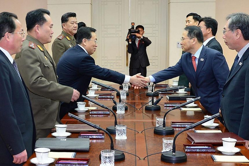 Head of the North Korean high-level delegation Won Tong Yon (third from left) shakes hands with his South Korean counterpart Kim Kyou-hyun (second from right) during their talks at the truce village of Panmunjom in the Demilitarised Zone (DMZ) on Feb
