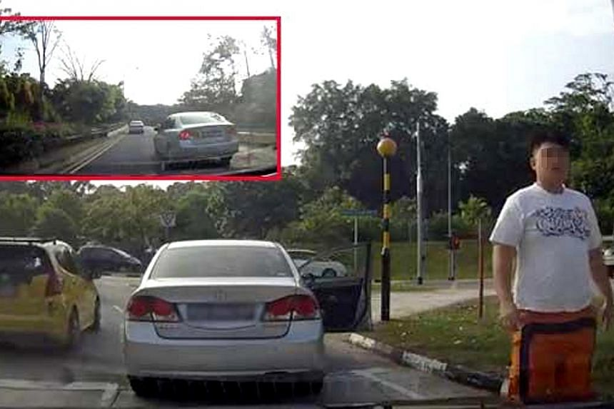 "Screenshot from a video from YouTube posted on Stomp website showing the driver of a Honda Civic getting out of his car to confront another driver. The Honda Civic driver branded a ""road bully"" by netizens because of two online videos showing hi"