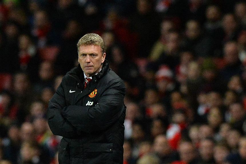 Manchester United's Scottish manager David Moyes looks on during the English Premier League football match between Arsenal and Manchester United at the Emirates Stadium in London on Feb 12, 2014.English football champions Manchester United will