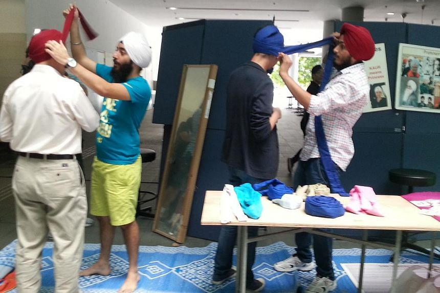SMU students at a turban tying booth during theinaugural SMU Langar Day - Sharing CommUNITY Love event, which celebrates Sikh culture and tradition.Other activities during the three hour event incudedtraditional Sikh dance per