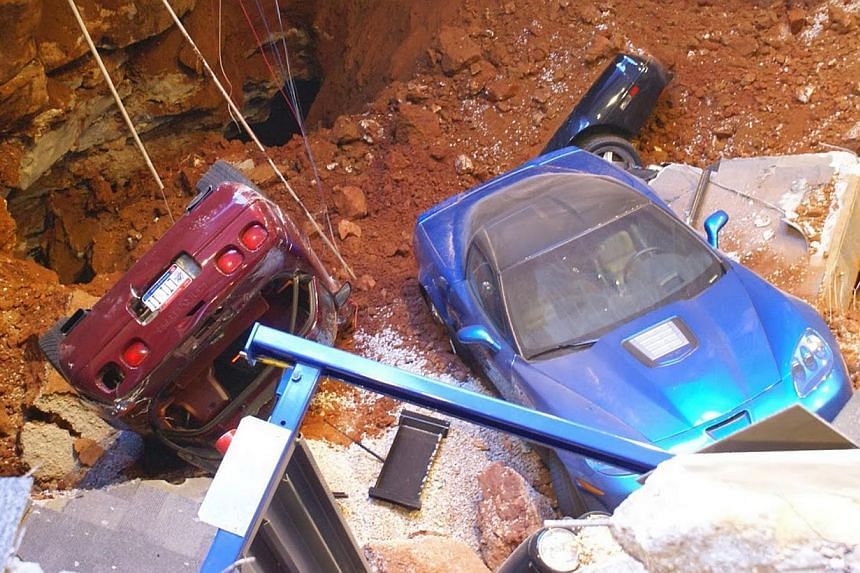 A 12.2m sinkhole that opened up under the National Corvette Museum and swallowed eight Corvettes, including the historic 1992 White 1-millionth Corvette, in Bowling Green, Kentucky, on Feb 12, 2014. -- PHOTO: REUTERS/NATIONAL CORVETTE MUSEUM