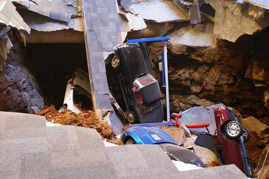 A 12.2m sinkhole that opened up under the National Corvette Museum and swallowed eight Corvettes, including the historic 1992 White 1-millionth Corvette, in Bowling Green, Kentucky on Feb 12, 2014. -- PHOTO: REUTERS/NATIONAL CORVETTE MUSEUM