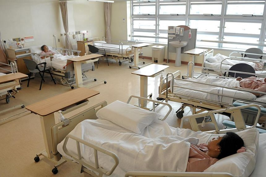 The Chinese New Year brought welcome relief to public hospitals in Singapore, with bed occupancy falling to an average of 66.3 per cent on Jan 31, 2014. -- ST FILE PHOTO: CAROLINE CHIA