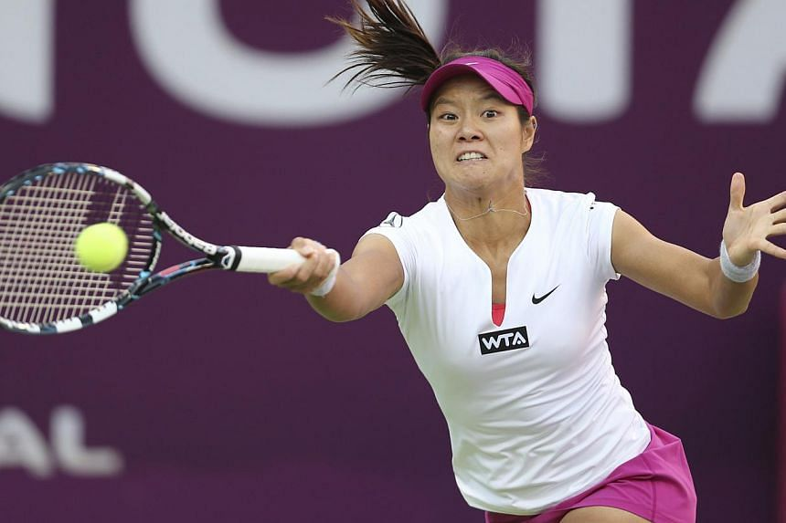 Li Na of China hits a return to Magdalena Rybarikova of Slovakia during their Qatar Open women's tennis match in Doha, on Feb 12, 2014.Top-seeded Li Na's Australian Open triumph last month was followed by a stunning tumble when she lost to a qu