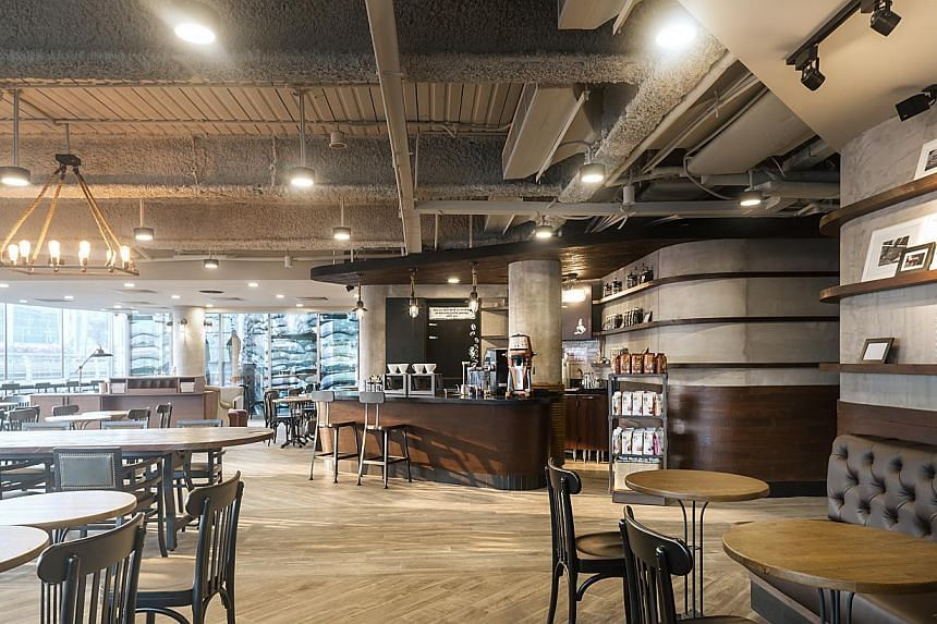 Starbucks opened its 100th store in Singapore on Feb 14, 2014, and joined a growing list of companies that have hired people with special needs.-- PHOTO: STARBUCKS