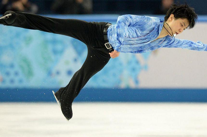 Japan's Yuzuru Hanyu performs during the Men's Figure Skating Short Program at the Iceberg Skating Palace during the Sochi Winter Olympics on Feb 13, 2014. Japanese star Yuzuru Hanyu gave a stunning display to put him on the road to Olympic gol