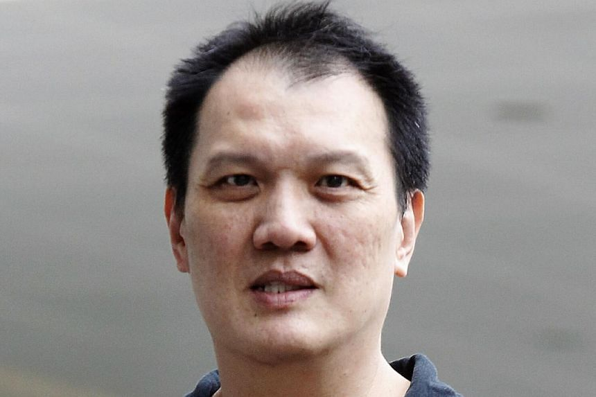 Former bus driver Chan Mun Hing, 48, pleaded guilty on Feb 14, 2014 to driving negligently and causing the death of the wife of a prominent professor at a pedestrian crossing in Clementi in April last year. -- ST PHOTO: WONG KWAI CHOW