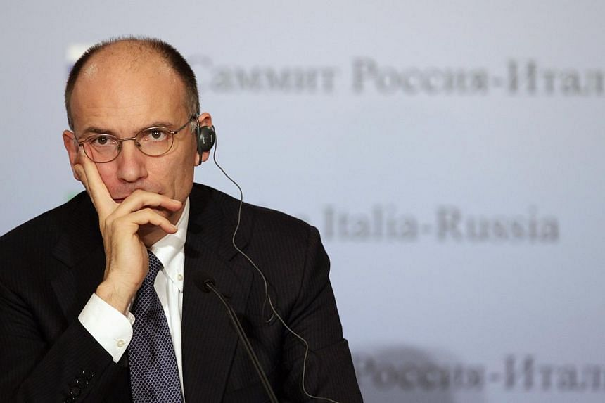 File picture of former Italian Prime Minister Enrico Letta during a news conference with Russia's President Vladimir Putin in Trieste last year. -- PHOTO: REUTERS