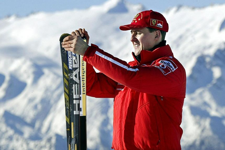 """Michael Schumacher's family said on Feb 13, 2014, that they continue to """"strongly believe"""" that the Formula One legend will recover from a life-threatening skiing accident. -- FILE PHOTO: AFP"""