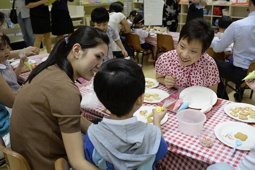 Minister Grace Fu (right) speaking with Sue Tan, 35, and her son Ashton Kee, 4, at Little Skool House, OCBC Centre.The National Trades Union Congress' (NTUC) call for companies to extend family care benefits to all employees with dependents, on top o