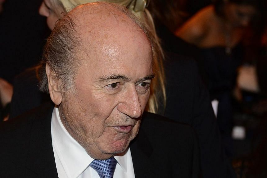 The long-running debate over the so-called triple punishment could be ended if referees used more intuition and sensitivity, Fifa president Sepp Blatter said on Friday, Feb 14, 2014. -- FILE PHOTO: AFP
