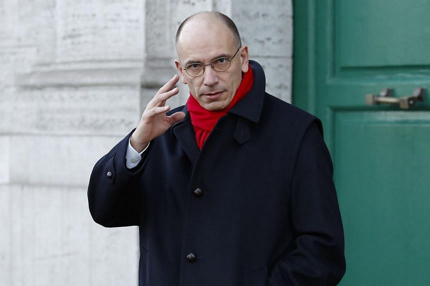 Italy's Prime Minister Enrico Letta gestures as he leaves his house in downtown Rome, on Feb 14, 2014. MrLetta will formally step down on Friday, Feb 14, 2014, in a flash political crisis and his 39-year-old leftist challenger Matteo Renzi is p
