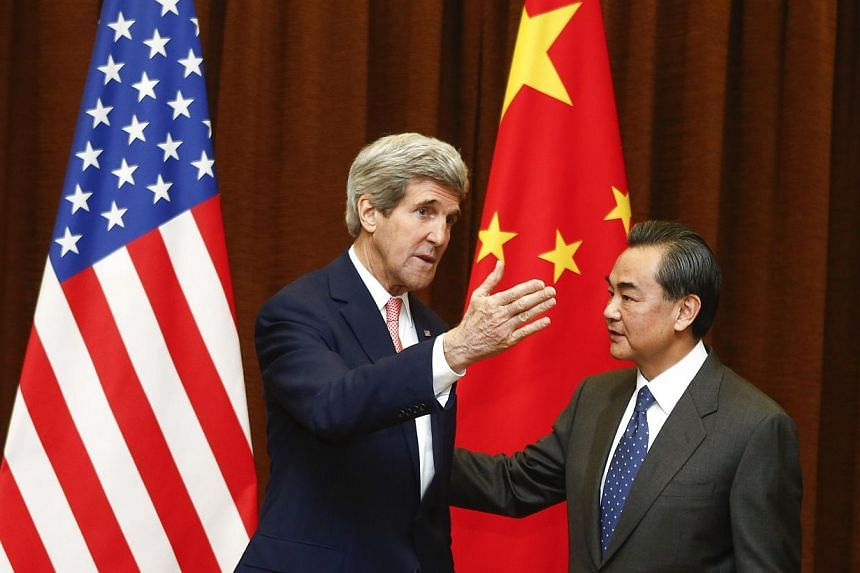 US Secretary of State John Kerry (left) meets with Chinese Foreign Minister Wang Yi (right) at the Ministry of Foreign Affairs in Beijing, on Feb 14, 2014. Chinese Foreign Minister Wang Yi told visiting US Secretary of State John Kerry on Friday, &nb