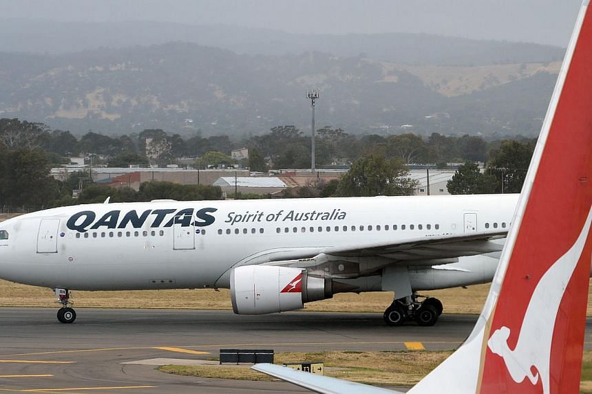 Australian Prime Minister Tony Abbott on Feb 14, 2014, said there will be no taxpayer handouts for struggling national carrier Qantas, but flagged support for lifting foreign ownership restrictions on the airline. -- FILE PHOTO: AFP