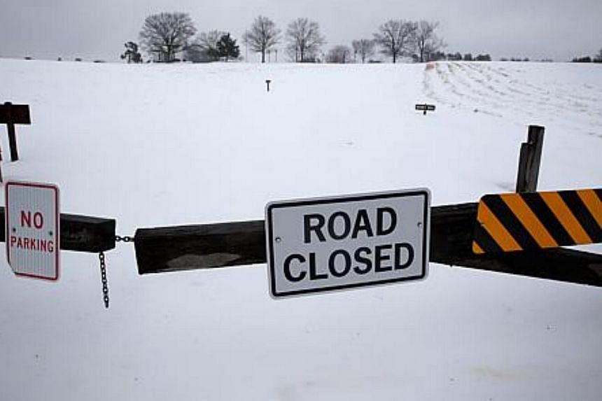 The entrance to the visitor centre of Manassas National Battlefield Park is closed due to a snow storm, on Feb 13, 2014, in Manassas, Virginia. -- PHOTO: AFP