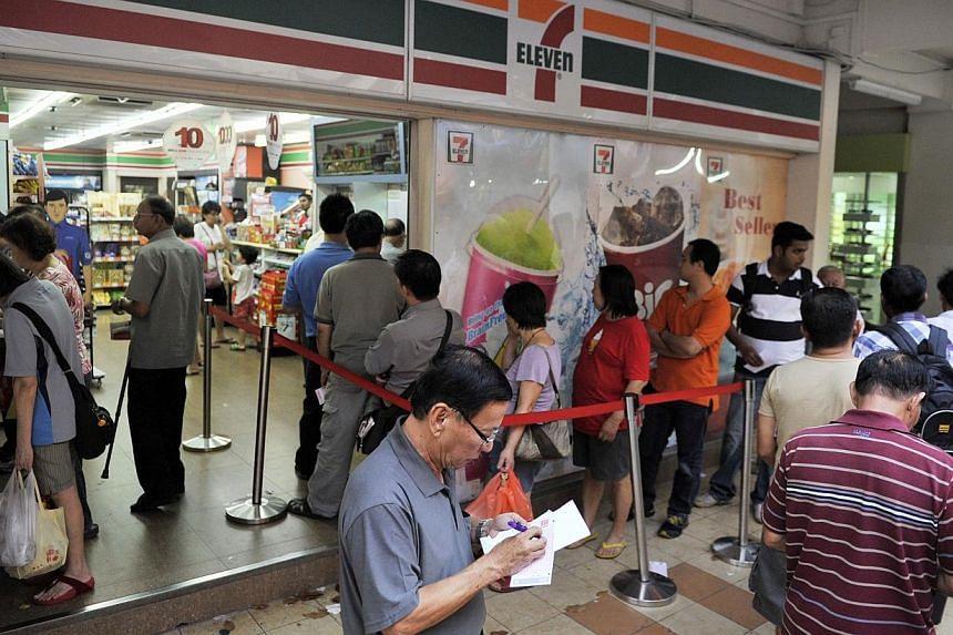 The Toto queue at Blk 102 Yishun Ave 5. -- ST FILE PHOTO: MATTHIAS HO