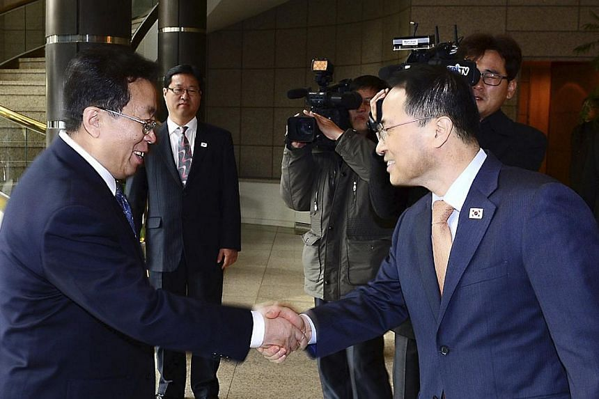 Head of the North Korean high-level delegation, Won Tong Yon (left) shakes hands with his South Korean counterpart Kim Kyou-hyun upon his arrival at the Peace House on the southern side of the truce village of Panmunjom in the demilitarised zone, nor