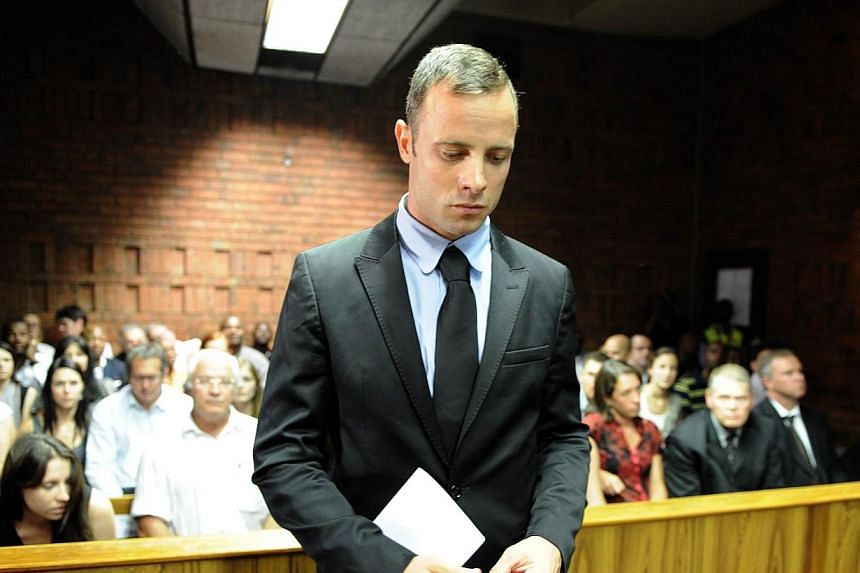 """South African Olympic sprinter Oscar Pistorius appears, on Feb 20, 2013 at the Magistrate Court in Pretoria. Pistorius said on Friday, Feb 14, 2014, he was consumed with """"sorrow"""" as he marked one year since he shot dead his girlfriend on Valentine's"""