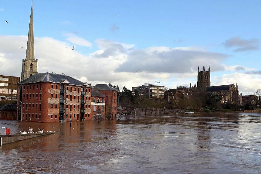 Floodwater is pictured in the town of Worcester in western England, on Friday, Feb 13, 2014. Princes William and Harry pitched in for flood victims on Friday as a new winter storm barrelled towards Britain, threatening fresh misery after the wettest