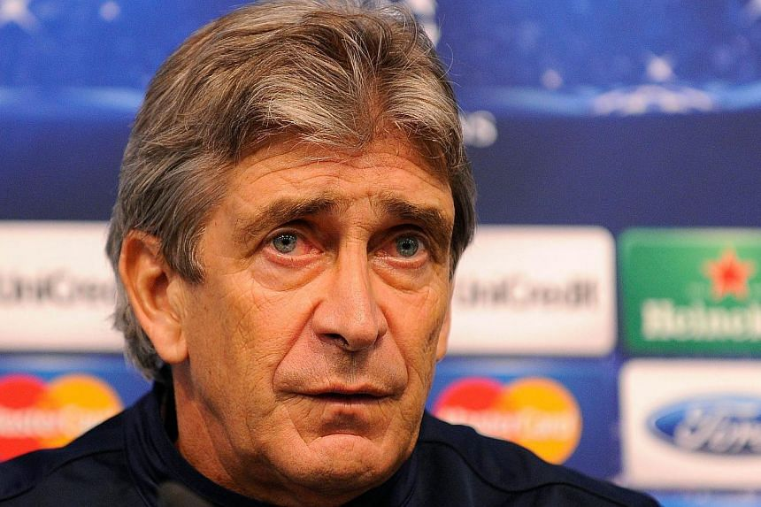 Manchester City's Chilean manager Manuel Pellegrini addresses the media during a press conference at The City of Manchester stadium in north-west England, on Nov 26, 2013.Manchester City manager Manuel Pellegrini is concerned his side may suffe