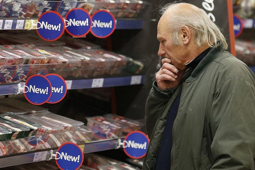 A customer looks at a meat display at a Tesco store in Bishop's Stortford, southern England in this file photograph taken on Nov 26, 2012. The European Union (EU) will carry out a second round of tests to see if horsemeat is being passed off as