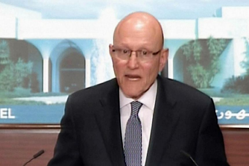 An image grab from the Tele Liban shows Lebanese prime minister-designate Tammam Salam, adressing the media to announce from the presidential palace in Baabda, the formation of a new Lebanese government following a 10-month vacuum. -- PHOTO:AFP