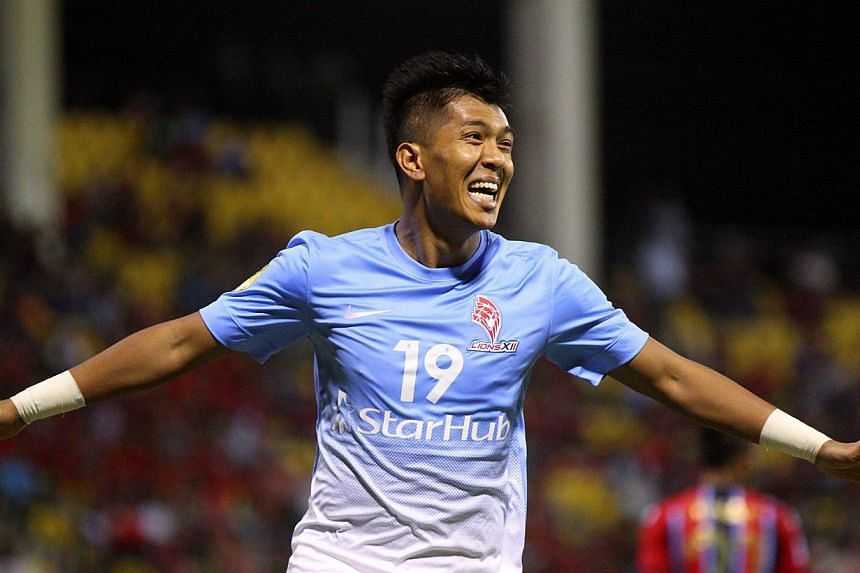 LionsXII's Khairul Amri celebrates after scoring his side's first goal against ATM FA.Centre-back Afiq Yunos scored deep into stoppage time to hand the LionsXII a dramatic 2-1 win at the Selayang Stadium on Saturday, Feb 15, 2014. -- TNP PHOTO: