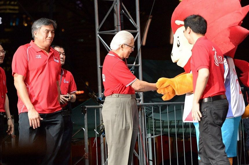 Guest of honour President Tony Tan Keng Yam shakes hands withNila.-- ST PHOTO: DESMOND WEE