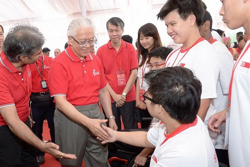 Guest of honour President Tony Tan Keng Yam at the launch party for thecountdown to the 2015 Singapore SEA Games.-- ST PHOTO: DESMOND WEE