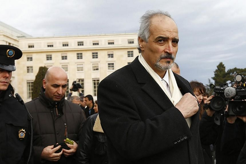 Bashar Jaafari (right) Syrian government's ambassador to the United Nations, leaves after his address to the media after a meeting at the Geneva Conference on Syria at the United Nations European headquarters in Geneva, on Saturday, Feb 15, 2014.&nbs