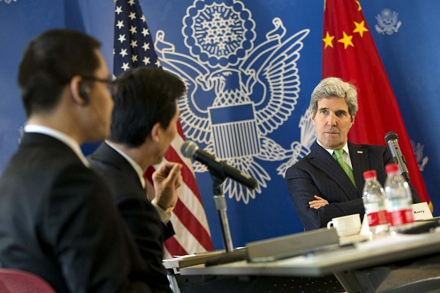 United States Secretary of State John Kerry (right) listens to a question during a discussion with Chinese bloggers in Beijing, on Saturday, Feb 15, 2014.The bloggers urged Mr Kerry to push for greater freedom online in China, asking for help t