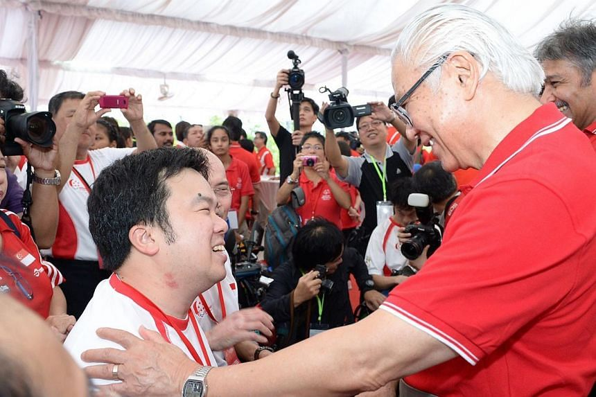 (Left) President Tony Tan chatting with Mr Jason Chee at the launch party yesterday for next year's SEA Games. Mr Chee lost both legs, his left arm and three fingers on his right hand after a ship accident in December 2012.  Meet Nila, the mascot (ri