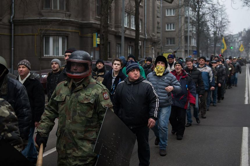 Anti-government protesters march in the streets of Kiev, on Feb 15, 2014. -- PHOTO: AFP