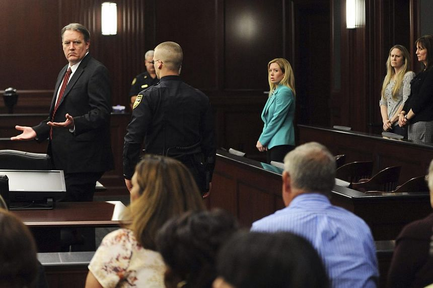 Michael Dunn (left) reacts disbelief as he looks at his parents after the verdicts were announced in his trial in Jacksonville, Florida on Feb 15, 2014. -- PHOTO: REUTERS