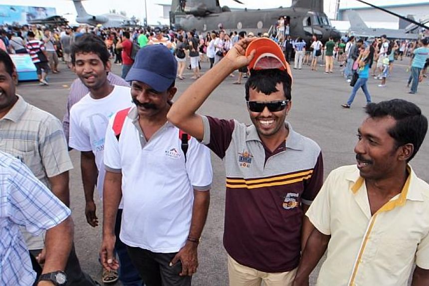 Mr Manickam Ramesh (foreground, second from right), 31, enjoys an outing with his friends as they check out the static display area at the Singapore Airshow 2014 on Sunday, Feb 16, 2014. They are part of a group of 100 foreign workers whose dormitory