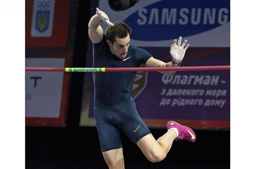 Renaud Lavillenie of France establishes a pole vault indoor world record as he competes in the Pole Vault Stars meeting in Donetsk, Feb 15, 2014.New pole vault world record holder Renaud Lavillenie could miss the world indoor championships in P
