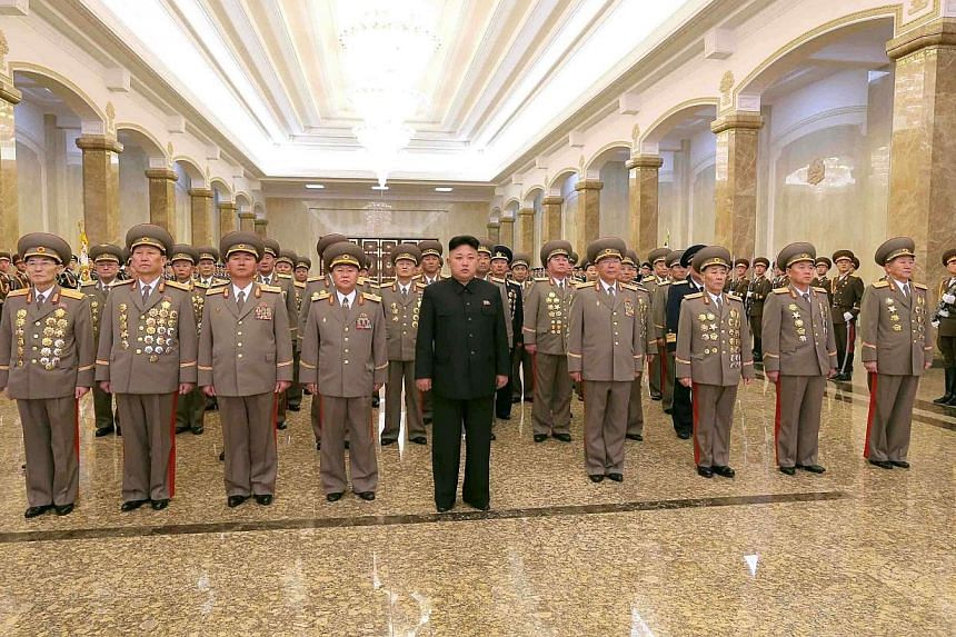 North Korean leader Kim Jong Un (centre) visits the Kumsusan Palace of the Sun on the 72nd birth anniversary of North Korea's late leader Kim Jong Il in this photo released by North Korea's Korean Central News Agency (KCNA) in Pyongyang, on Sunday, F