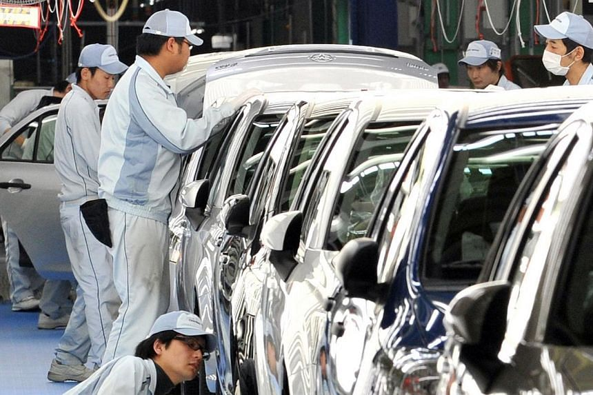 """Toyota workers checking paints and bodies of Toyota Motor's best selling car """"Corolla"""" at Toyota Motor East Japan's Ohira at Ohira village in Miyagi prefecture, northern Japan, on May 11, 2012.Japan's unions have started demanding wage hikes fr"""