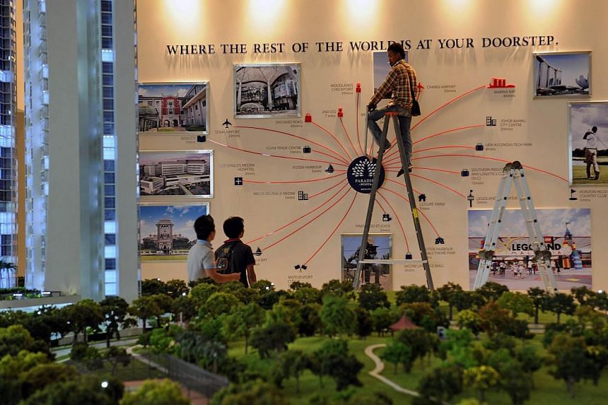 SHOPPERS' HAVEN:  The Sutera Mall in Johor. With the falling ringgit, bargain hunters are seeing their Singdollars stretch further.  CHEAPER HOMES:  Workers at a condominium launch in Nusajaya, Johor Baru, last November. Singapore property buyers are