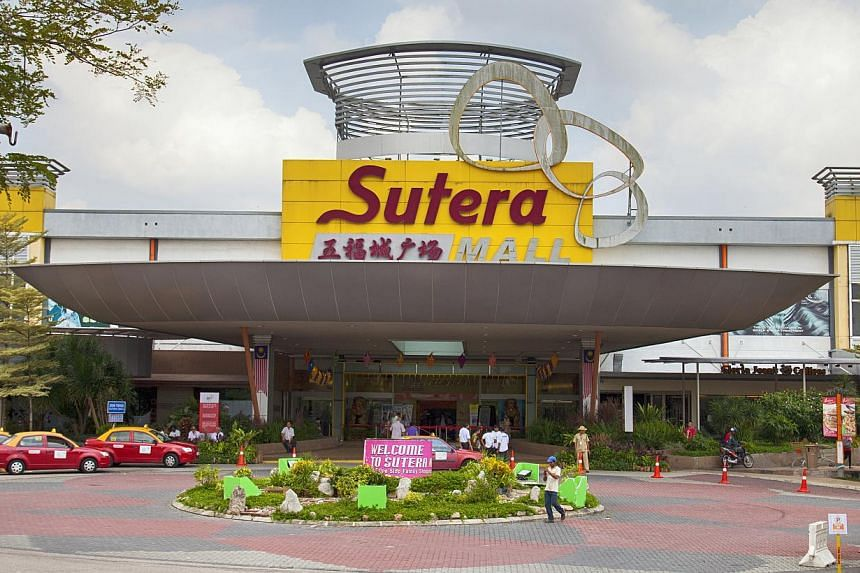SHOPPERS' HAVEN: The Sutera Mall in Johor. With the falling ringgit, bargain hunters are seeing their Singdollars stretch further. -- PHOTO: TANAHSUTERA