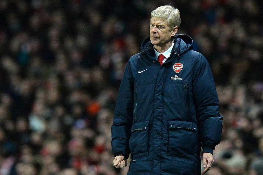 """Arsenal manager Arsene Wenger insisted on Sunday, Feb 16, 2014, that comments from Chelsea rival Jose Mourinho that he was a """"specialist in failure"""" were """"silly"""" and """"disrespectful"""". -- FILE PHOTO: AFP"""
