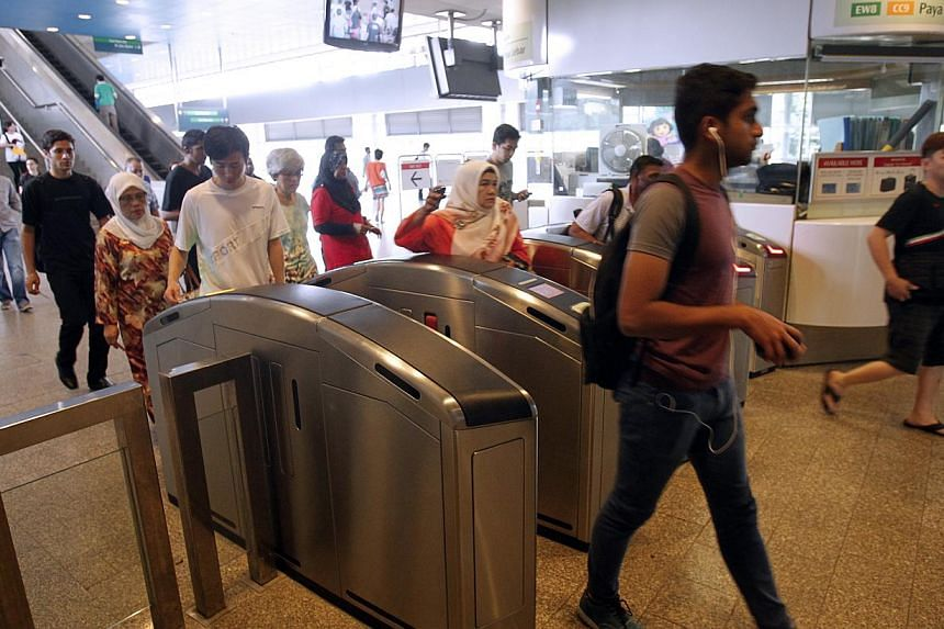 Rail operators SMRT and SBS Transit stand to face much heftier fines for train disruptions in future, after Parliament passed a Bill on Monday to raise the maximum penalty to 10 per cent of the annual fare revenue of a rail line. -- ST FILE PHOTO:&nb