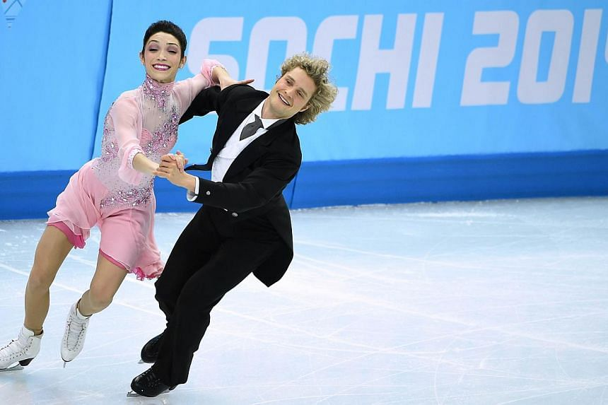 US Meryl Davis and US Charlie White perform in the Figure Skating Ice Dance Short Dance at the Iceberg Skating Palace during the Sochi Winter Olympics on Feb 16, 2014. Davis and White set a new world record in the short dance at the Olympics on Sunda