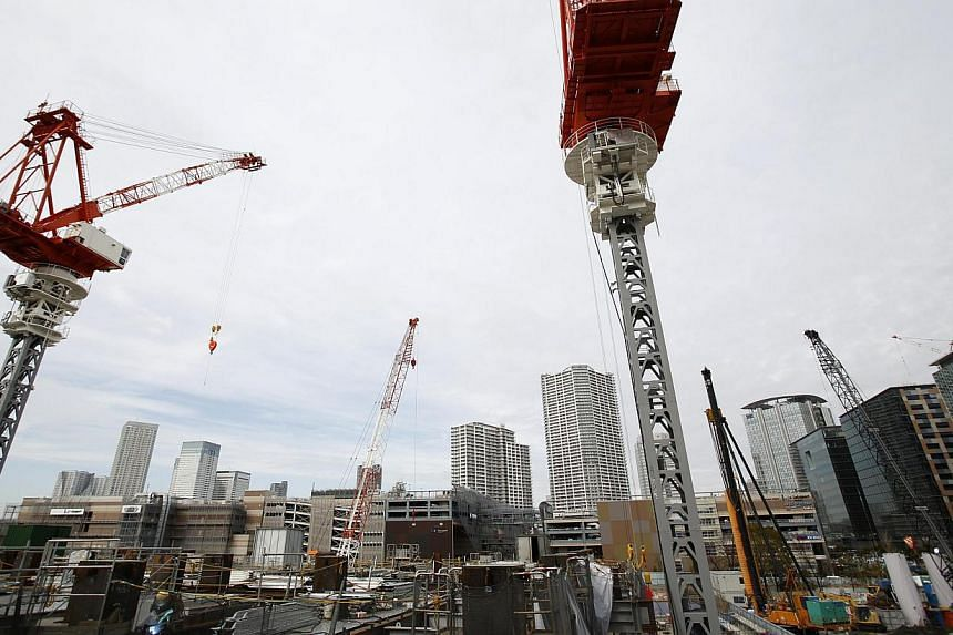 Heavy machineries are seen in a construction site in Tokyo on Feb 12, 2014. -- FILE PHOTO: REUTERS
