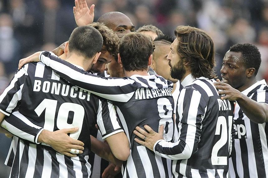 Juventus' Fernando Llorente (second left) celebrates with team mates after scoring against Chievo Verona during their Italian Serie A soccer match at Juventus Stadium in Turin on Feb 16, 2014. A bizarre own goal briefly gave Serie A leaders Juventus