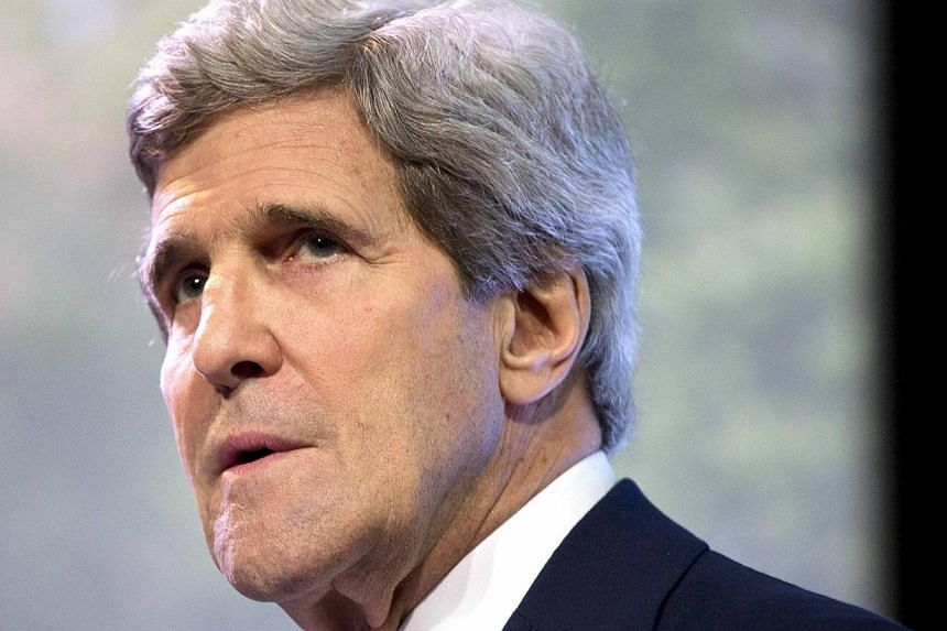US Secretary of State John Kerry pauses as he delivers a speech on climate change in Jakarta on Feb 16, 2014. -- PHOTO: REUTERS