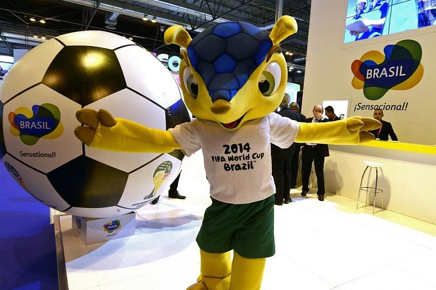 Official mascot of the 2014 Fifa World Cup Fuleco the Armadillo poses at Brazil's stand during the International Tourism Trade Fair in Madrid on Jan 22, 2014. -- FILE PHOTO: AFP