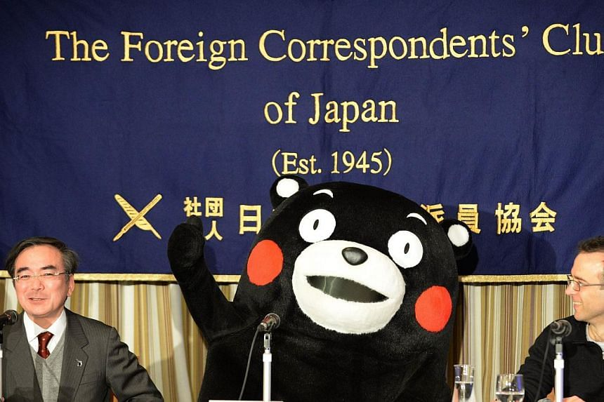 Kumamon gestures during a press conference at the foreign correspondents' club in Tokyo on Feb 14, 2014. The life-size bear mascot with red cheeks and no voice held a press conference in Tokyo on Feb 14, the latest public relations coup for the rural