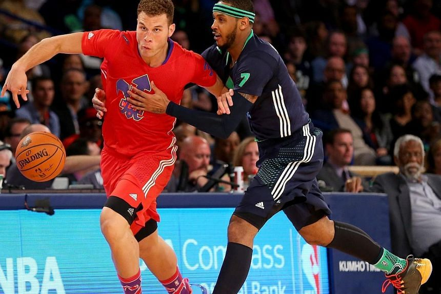 The Western Conference's Blake Griffin(left) of the Los Angeles Clippers is fouled by the Eastern Conference's Carmelo Anthony the New York Knicks during 2014 NBA All-Star game at the Smoothie King Center on Feb 16, 2014 in New Orleans, Louisiana.&nb